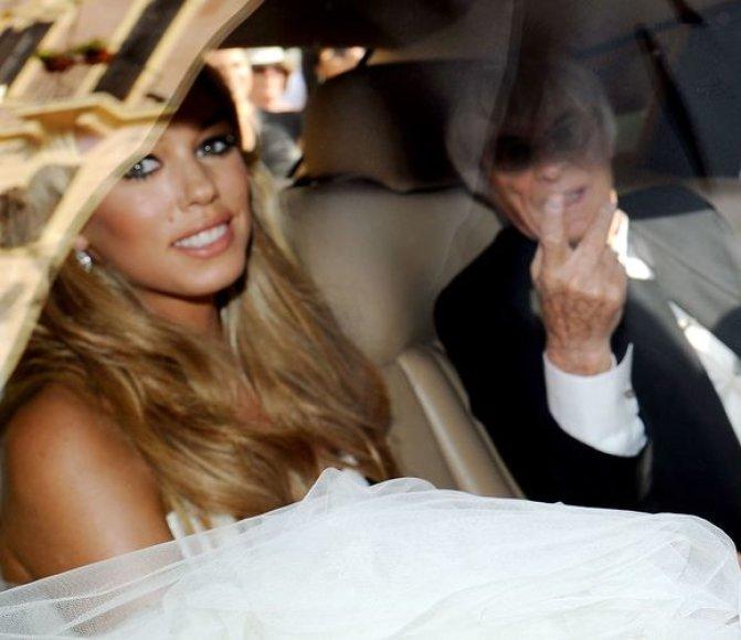 Petros Ecclestone su garsiuoju tėvu Bernie Ecclestone vestuvių dieną