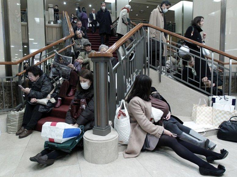 Tragedijos sukrėsti Japonijos gyventojai