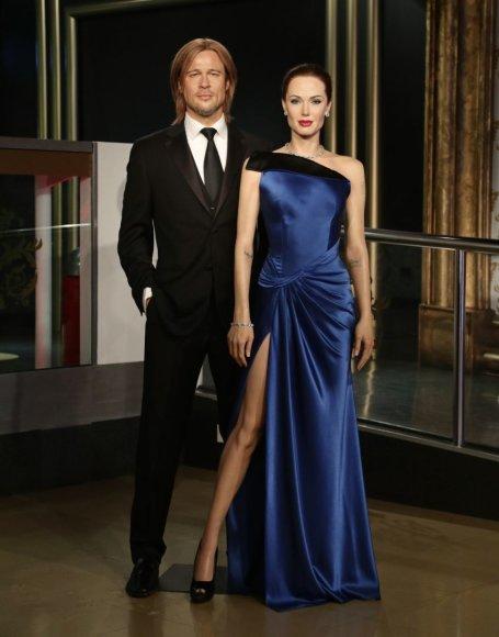 """""""Scanpix""""/""""PA Wire""""/""""Press Association Images"""" nuotr./Brado Pitto ir Angelinos Jolie vaškinės figūros """"Madame Tussauds"""" muziejuje"""