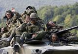 """""""Reuters""""/""""Scanpix"""" nuotr./Rusijos kariai traukiasi iš Gruzijos."""