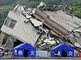 """AFP/""""Scanpix"""" nuotr./Galingas žemės drebėjimas Kinijoje nusinešė 69 tūkst. gyvybių."""