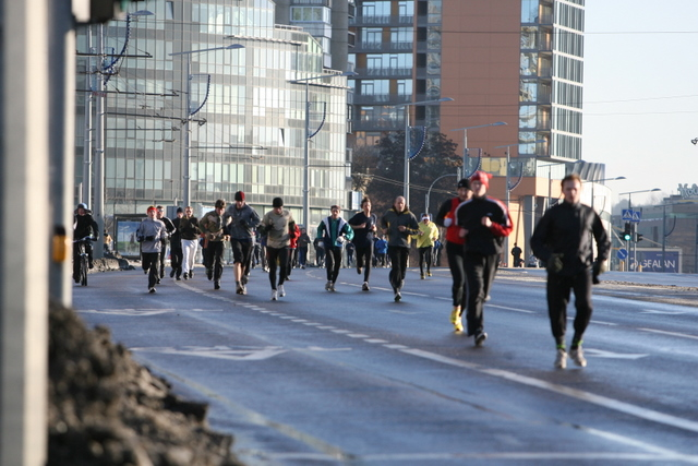 Bėgimo dalyviai Vilniaus gatvėse