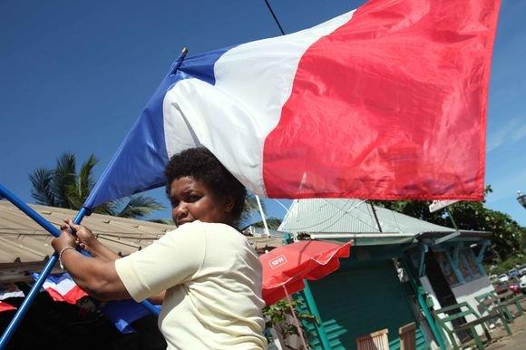 AFP/Scanpix nuotr./Majoto salos rinkėjai sekmadienį referendume balsavo už tai, kad jų sala taptų visaverte Prancūzijos dalimi.