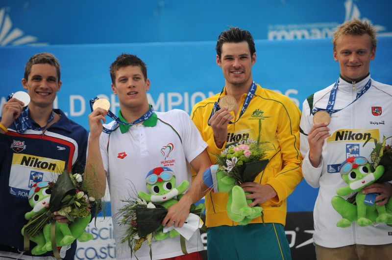 Plaukikas iš Lietuvos Giedrius Titenis (pirmas iš dešinės) Romoje vykstančiame pasaulio vandens sporto šakų čempionate iškovojo bronzos medalį.