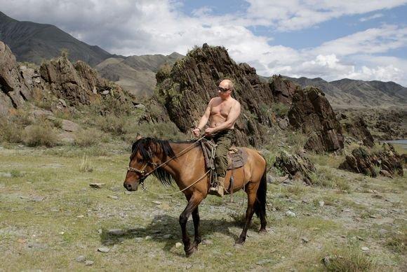 AFP/Scanpix nuotr./Putino atostogų akimirka