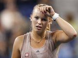 """""""Reuters""""/""""Scanpix"""" nuotr./Finale pralaimėjusi danė C.Wozniacki tenkinosi 0,8 mln. JAV dolerių čekiu"""