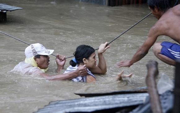 Tropinis uraganas Ketsana Filipinuose sukėlė didžiulius potvynius.