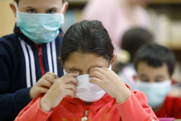 Vaikai saugosi gripo