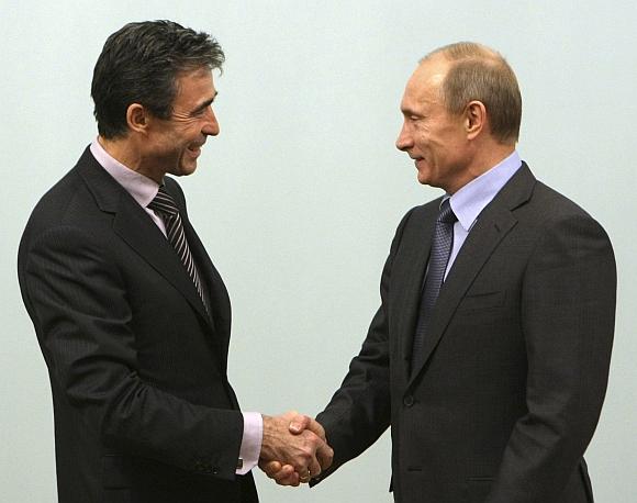 Andersas Foghas Rasmussenas ir Vladimiras Putinas