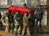 AFP/Scanpix nuotr./Ia avarijos vietos ianeaami ir į Maskvą iagabenami žuvusiųjų kūnai.