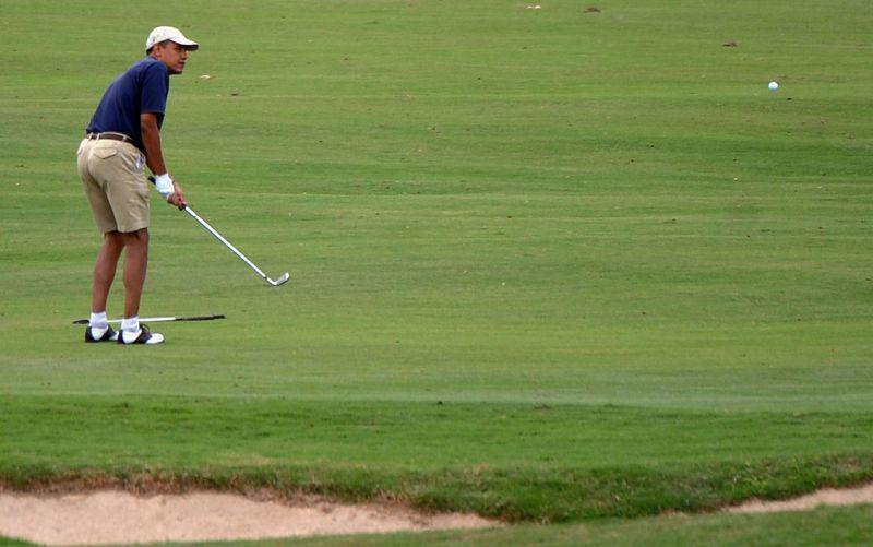 B.Obama – golfo aikštyne.