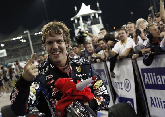 Scanpix nuotr./S.Vettelis tapo jauniausiu Formulės 1 čempionu istorijoje