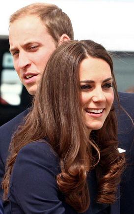 """AFP/""""Scanpix"""" nuotr./Princas Williamas ir Kembridžo hercogienės Catherine"""
