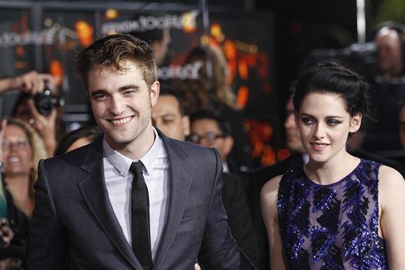 Reuters/Scanpix nuotr./Robertas Pattinsonas ir Kristen Stewart