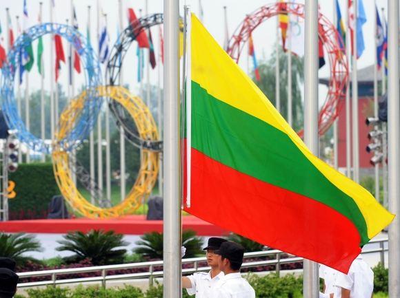Scanpix/Xinhua nuotr./Lietuvos trispalvė olimpinėse žaidynėse