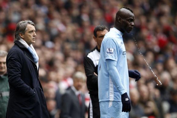 Reuters/Scanpix nuotr./Roberto Mancini ir Mario Balotelli