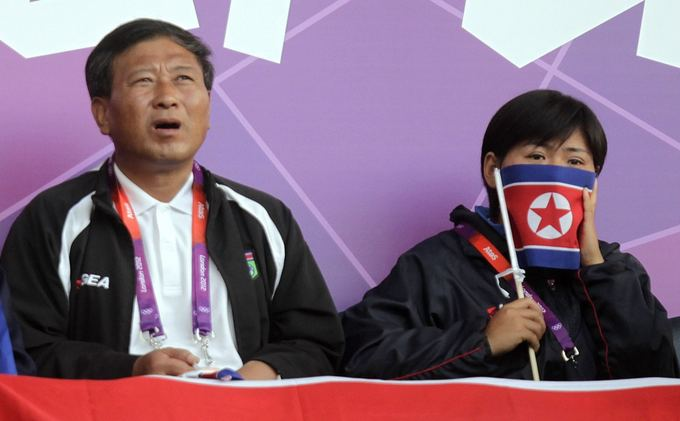 AFP/Scanpix nuotr./`iaurės Korėjos atstovai