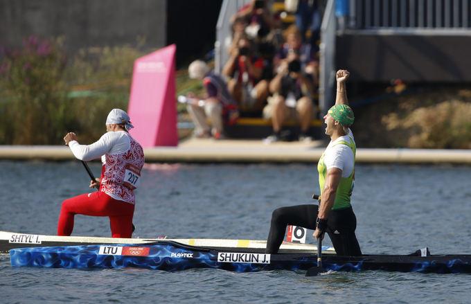 Reuters/Scanpix nuotr./Jevgenijus `uklinas triumfuoja po finiao