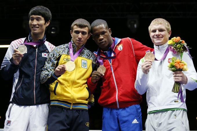 AFP/Scanpix nuotr./Soonchulas Hanas, Vasilijus Lomačenka, Yasnielis Toledo Lopezas ir Evaldas Petrauskas