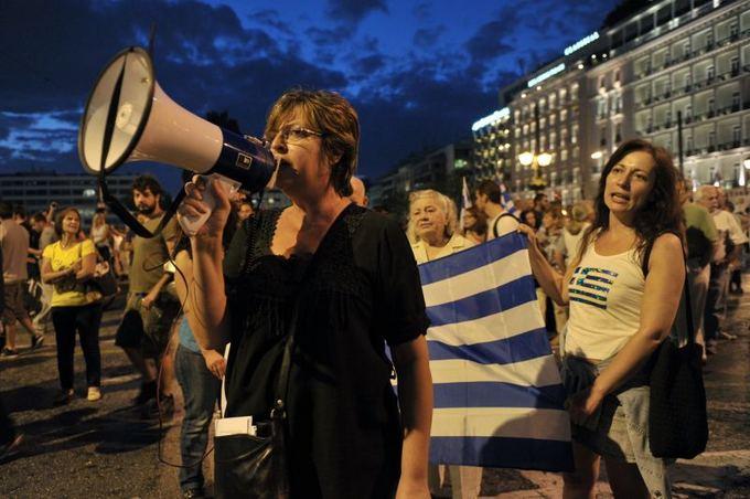 AFP/Scanpix nuotr./Graikai lieja įtūžį ant A.Merkel, kuri esą kalta, kad aalis priversta taupyti iki begalybės.