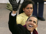 AFP/Scanpix nuotr./Barackas Obama su žmona Michelle
