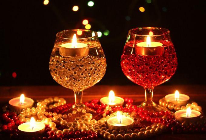 Fotolia nuotr./Plūduriuojančių žvakių kompozicija