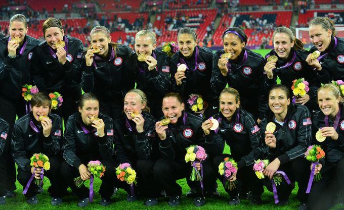 AFP/Scanpix nuotr./JAV moterų futbolo rinktinė  olimpinė čempionė.