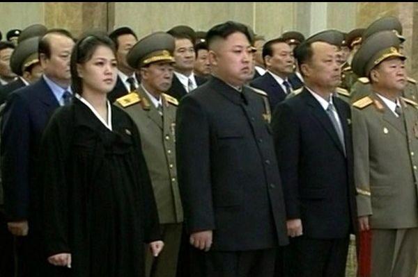 AFP/Scanpix nuotr./`iaurės Korėjos lyderis su žmona