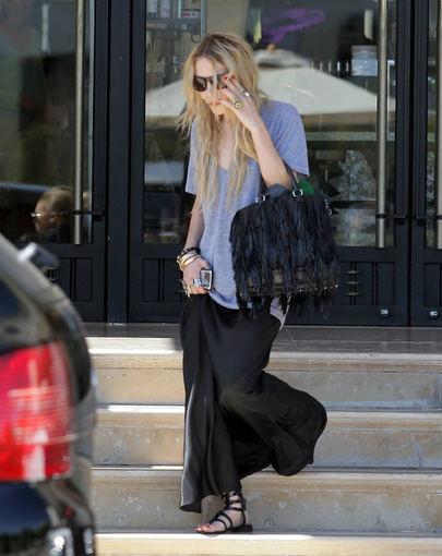 Scanpix nuotr./Olsen dvynukė fotografų dažnai užfiksuojama, dėvinti apsmukusius ir per didelius drabužius.