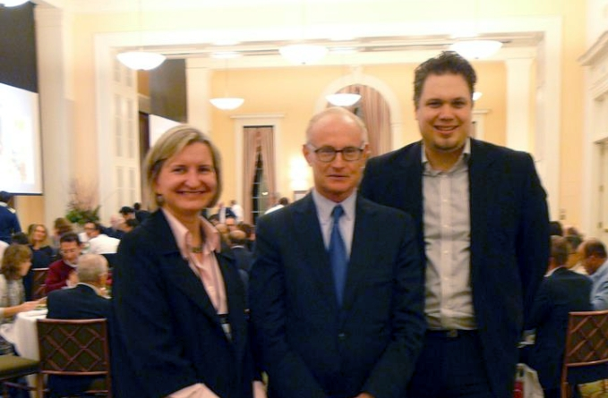 Michael Porter (center) with Virginija Poškutė and Maik Huettinger of ISM University of Management and Economics