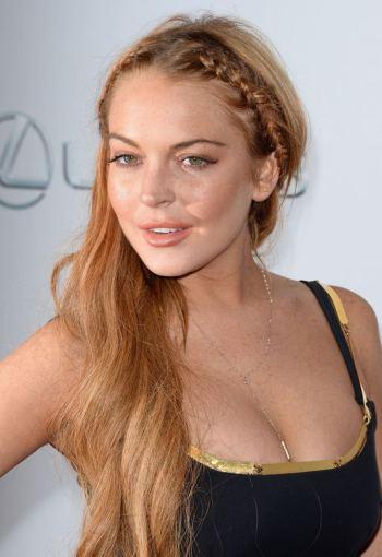 """AFP/""""Scanpix"""" nuotr./Lindsay Lohan filmo """"Pats baisiausias filmas 5"""" premjeroje"""