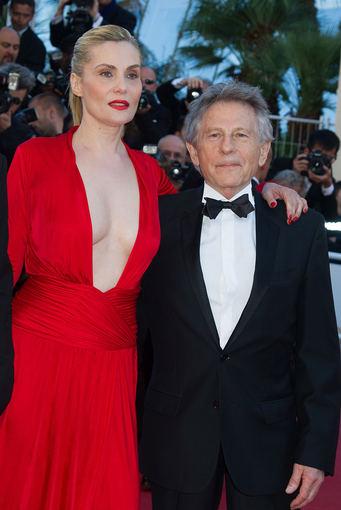 """""""Scanpix"""" nuotr./Režisierius Romanas Polanskis ir jo žmona aktorė Emmanuelle Seigner žino, kad ant raudonojo kilimo pasipuošti raudona rizikinga."""