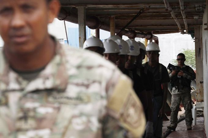 Reuters/Scanpix nuotr./Sulaikytame `iaurės Korėjos laive aptikta ginklų kontrabanda.