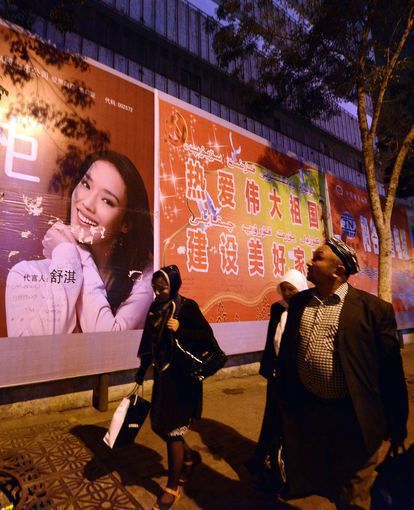 "AFP/""Scanpix"" nuotr./Sindziango sostinės Urumči gatvė"