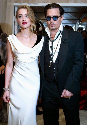 "AFP/""Scanpix"" nuotr./Johnny Deppas ir Amber Heard"