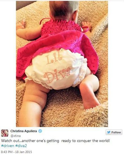 """""""Twitter"""" nuotr./Christina Aguilera paviešino pirmąją dukters Summer Rain nuotrauką"""