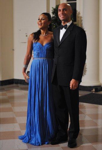 "AFP/""Scanpix"" nuotr./Adrianas Fenty su pirmąja žmona Michelle (2009 m.)"