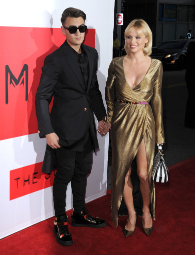 """Scanpix"" nuotr./Pamela Anderson su sūnumi Brandonu Lee"