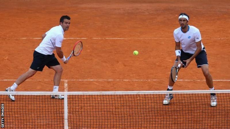 Daniele Bracciali (kairėje) ir Potito Starace (dešinėje) dvejetų turnyre 2014 metais