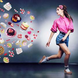Fotolia nuotr./Nuo maisto mėganti mergina