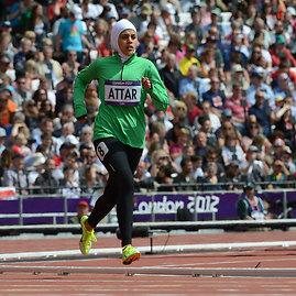 """AFP/""""Scanpix"""" nuotr./Saudo Arabijos bėgikė Sarah Attar"""