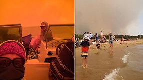 Dienai virtus naktimi, žmonės skubėjo slėptis valtyse: šėlstantys gaisrai paplūdimiuose įkalino tūkstančius