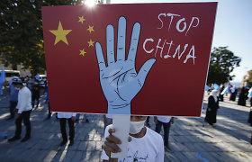 """Kinijos """"Alibaba"""" sako """"sunerimusi"""" dėl uigūrų veidų atpažinimo programos"""