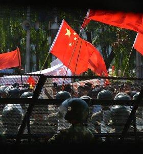 Valdžios persekiojami Kinijos aktyvistai darosi vis išradingesni