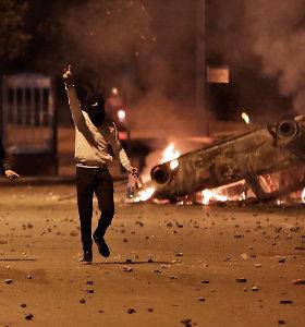 Libane per šiitų partijų rėmėjų ir policijos susirėmimus buvo sužeisti dešimtys žmonių