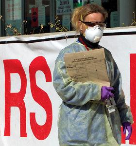 Kinijoje dėl naujo viruso protrūkio uždarytas dar vienas miestas