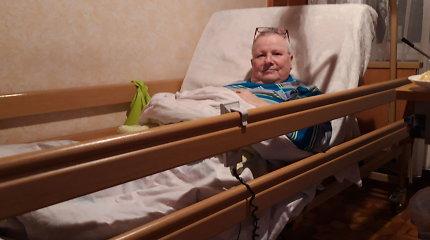 Po insulto paralyžiuotai moteriai sumažinta neįgalumo išmoka, nes ji sugeba pakelti vieną ranką