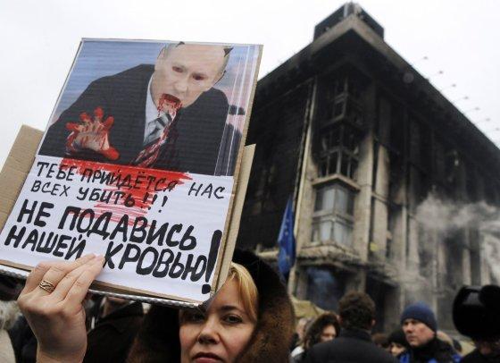 """AFP/""""Scanpix"""" nuotr./Protesto akcija prieš Vladimiro Putino sukeltą karą Ukrainoje"""