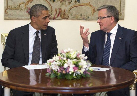 """AFP/""""Scanpix"""" nuotr./JAV prezidentas Barackas Obama ir Lenkijos prezidentas Bronislawas Komorowskis"""