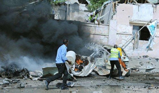 """AFP/""""Scanpix"""" nuotr./Sprogimo padariniai Mogadiše"""